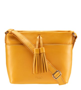 The Savanna Leather Cross-Body in mustard yellow | OSPREY LONDON