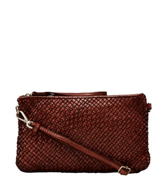 The Alia Leather Slimline Cross-Body Clutch in cognac | OSPREY LONDON