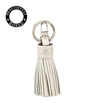 The Daria Leather Tassel Keyring in coconut white