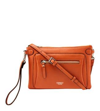 The Ruby Leather Cross-Body Clutch in marmalade orange | OSPREY LONDON