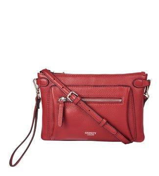 The Ruby Leather Cross-Body Clutch in garnet red | OSPREY LONDON